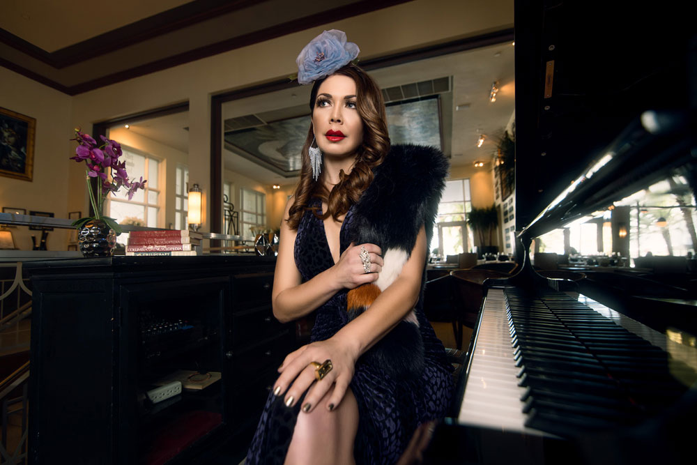 Shireen Sandoval fashion blog, Miami FL. Old Hollywood glamour style fascinator. Photographed on location at The National Hotel's Piano Bar, South Beach FL by James Woodley Photography. Also featured on Deco Drive TV. BCBG Miami Beach supplied the wardrobe from their Winter fashion collection. The faux fur wrap is designed by Ann Taylor.