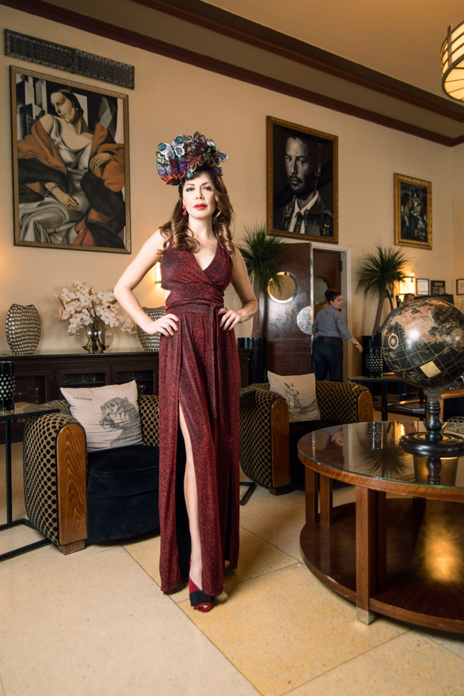 Shireen Sandoval fashion blog, Miami FL. The Old Hollywood glamour and style of fashionable fascinators. Hat and hairstyles for New Year's Eve. Sparkling red dress with red velvet shoes. Photographed on location at The National Hotel, South Beach FL by James Woodley Photography. Also featured on Deco Drive TV. BCBG Miami Beach supplied the wardrobe from their Winter fashion collection.