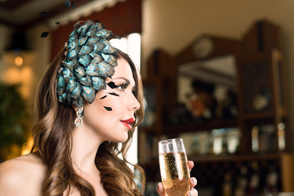Shireen Sandoval fashion blog, Miami FL. Old Hollywood glamour style fascinator. Photographed on location at The National Hotel, South Beach FL by James Woodley Photography. Also featured on Deco Drive TV. Topping It Off for 2018 with fashionable hats and hairstyles. Holiday hair and make-up and glamorous cocktail jewelry.